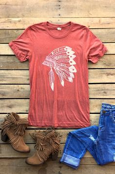 Our Wild, Barefoot, and Free Short Sleeve Tee is one of our staff's faves! It's a v-neck short sleeve tee with 'Wild, Barefoot, and Free' on the front with headpiece. Very comfortable and stylish!