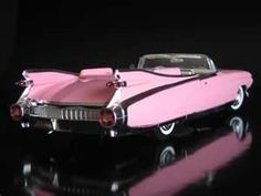 Pink 1959 Cadillac Eldorado. I was going to buy a hardtop of one of these, but my girl friend at the time didn't like it... Should have bought it.