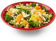 Piña Colada Salad: Chicken, Pineapple, Mandarin Oranges, Coconut, & Macadamia Nuts on Romaine Lettuce, & Pina Colada Vinaigrette Dressing.