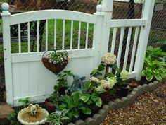 """my FREE """"garden gate""""...a twin bed headboard, rescued from a neighbor's trash...a dollar thrifted heart planter...a new coconut hull liner and 1 pot of peachy pink impatiens...still need to find a 'latch'...it's a work in progress  :)"""