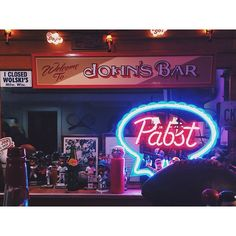 """Welcome to John's Bar"" sign by Jeff Williams. Dad's Christmas present last year."
