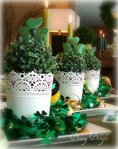 Dining Delight: St. Patrick's Day Table for Six. Like the trio of white lace look containers filled with faux boxwood and topped with shamrocks for a centerpiece