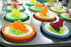 Dino cupcakes!! dinosaurs are fruit snacks!
