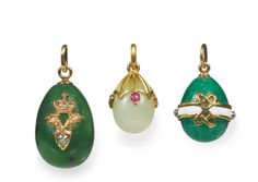 Three jewelled and gold-mounted hardstone egg pendants, St Petersburg | lot | Sotheby's