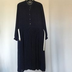 Pleated polka dots dress size 12 Long sleeves ,belt ,below knee length. Fits nicely to size 12 .Like new condition. Shelby Dresses