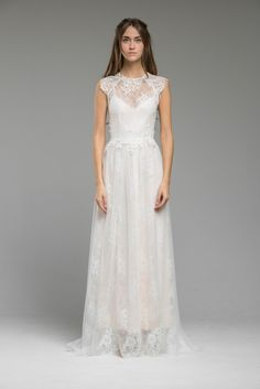 An elegant movement of French lace and tulle creates this gown. Scalloping detail join neckline to raglan style cut sleeves with a cap sleeve just resting softly on the tip of the shoulders. A linen bodice is incorporated in this gown to increase comfort, soft to the line. Lace flowers are hand sewn with care …