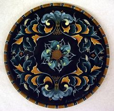 Gudbrandsdal---  Imitation of carving. Acanthus scrolls,leaves, in C with S extention. Tulips & 6-8 petal roses. Symmetrical