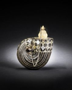 A mother-of-pearl and ivory-inlaid Powder Flask Gujerat or Sindh, 19th Century.    © Bonhams 2001-2014