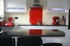 A Bright Red Acrylic Kitchen Splashback With A High Gloss Finish.
