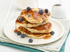 Blueberry Pancakes : Trisha's brunch-perfect pancakes are made with sour cream, lemon zest and blueberries (fresh or frozen berries will work just fine).