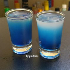 SEXY BLUE EYES 1 oz. (30ml) Blue Raspberry Vodka (Don't Use UV Blue, it must be clear) 1/2 oz. (15ml) Peach Schnapps 1/2 oz. (15ml) Lime Juice Shake with ice and pour Mix 1/2 oz Blueberry Schnapps and 1/2 oz Simple Syrup then drizzle in to make the blue gradient.