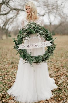 Want an alternative to a traditional welcome sign?  Say it with a gigantic ivy wreath positioned against an easel or hung from a gateway. @myweddingdotcom