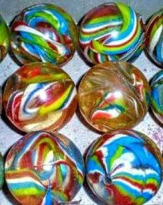 Multi-colored Bouncy Balls from the Vending Machines! I remember always asking my parents for quarters so I could get one of these.