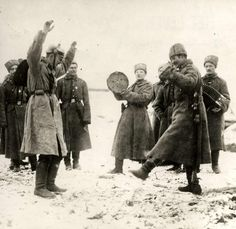 Russian soldiers teaching the Cossack dance to German prisoners of war. Eastern Front, 1915