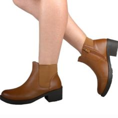 "Side elastic ankle height boots Side elastic boots for that comfortable fit with 2"" height . Price is firm unless bundled . Also available in other sizes . Shoes Ankle Boots & Booties"