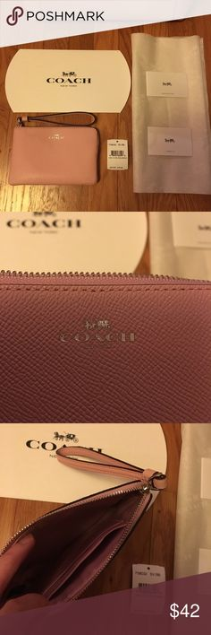 """New with tag Coach Wallet Wristlet! soft pink NWT NWT 100% Authentic Coach Wristlet.  Comes with gift box and logo tissue.  Perfect for Gift! See my closet for a matching color bag.  Check out my closet for more Coach, Michael Kors Wallet, bag, and purses!  All new with tag and authenticity guaranteed!!!  4"""" x 6"""" Coach Bags Clutches & Wristlets"""