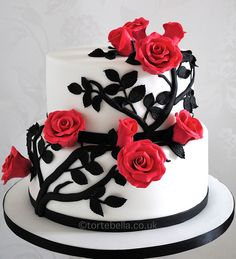 Monochrome (black and white) wedding cake with red roses.