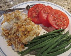 This Lemon Chicken Casserole served with tomatoes and green beans looks healthy and delicious!