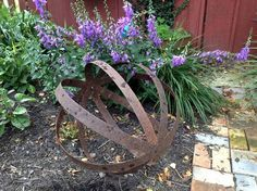 Rusty barrel hoops and spheres in the garden Myra Glandon says, I made this last weekend out of 4 metal barrel rings