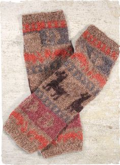 The cozy legwarmers are jacquard knit in bands of whimsical alpaca motifs in shades of taupe, lilac, chambray and rust.