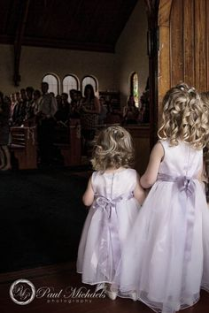 Flower girls walking into St Christophers church.