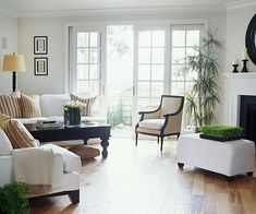 love the mix of white fabrics and dark woods