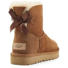 UGG Australia Mini Bailey Bow Shearling Lined Suede Boots (€179) ❤ liked on Polyvore featuring shoes, boots, bow boots, bow shoes, shearling lined shoes, shearling lined boots and ugg shoes
