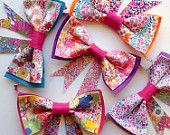 Bow Garland / Wall Hanging / Liberty Fabric / Girls Rainbow Bedroom Playroom Nursery Decor Decoration / Australian Made.   Shop Rhapsody and Thread via Etsy. Girls Rainbow Bedroom Decor Inspiration