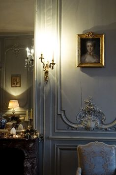 Framed portraits & brass sconce