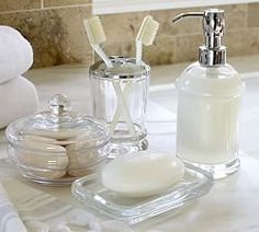 A matching set of marble accessories will make any bath look chic. Fashion designer Monique Lhuillier blends her sophisticated style and her love of celebration in this collection for Pottery Barn, featuring registry favorites for the bath, bedroo… Spa Like Bathroom, Glass Bathroom, Bathroom Sets, Parisian Bathroom, Rental Bathroom, Master Bathroom, Small Bathroom, Bathroom Cart, Spa Bathrooms