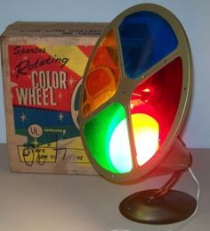 A revolving color lamp was focused on the aluminum Christmas trees to make them change colors.