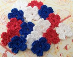 Crocheted Red White Blue Flowers by FineThreads on Etsy, $3.75
