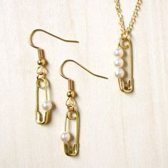 Delicate necklace and earring set made from Swarovski pearls and safety pins. Super simple to make!