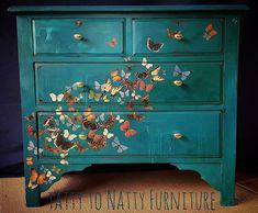 Butterflies painted on dresser