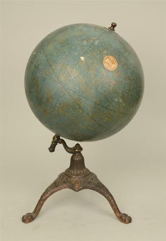CELESTIAL GLOBE, with cast iron tripod base; manufactured by Weber Costello Co., Chicago Heights, Ill.; circa 1900.