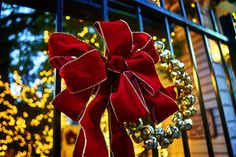Christmas. Red bows. Golden trim. Sparkling bulbs. Silver bells. Blue dusk. Details. All of them. They are part of the whole. Part of the photograph. Part of what we see and feel. .