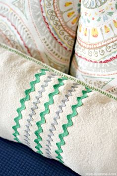 See how easy it is to make this DIY pillow from a drop cloth scrap and a little bit of fun trim!