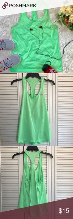 "Adidas women green racer back workout tank top This women workout tank top is come in strips green and light green color.  Round neck, racer back, light weight, breathable fabric and fabric stretchy. The front has a tiny torn, see last picture. Other than that, still in good condition.  Top to bottom: 24.5"" Chest: 16.5"" Material: 100% Polyester Measurement are base on item lay flat on the floor. Reasonable offer accept. adidas Tops Tank Tops"