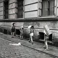 Eustachy Kossakowski - Children of cartons on their heads, Warsaw, 2007.