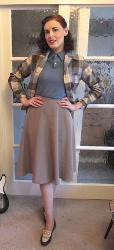 Vintage Vessel in an American Apparel skirt, late 1950s powder blue sweater, 1940s check jacket