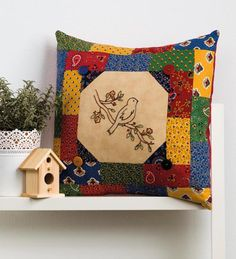Put a bird on it! Embroider a feathered friend onto this pretty patchwork pillow - use the fabric scraps you have on hand for an eclectic look.