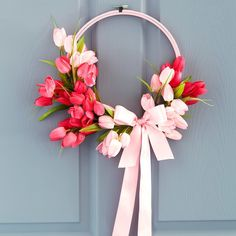 Add a pop of color to your home decor when you make this easy DIY Pink Tulip Wall Wreath