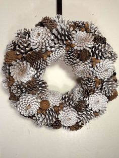 "18 pine cone wreath in white with natural colored pine cones and acorns. Beautiful winter decor that will last indefinitely.Képtalálat a következőre: ""pine cones ideas""Slikovni rezultat za how to make a wreath out of pine conesNatural Pinecon"