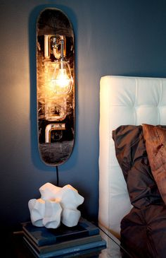 A repurposed skateboard deck paired with custom industrial cage lighting create a unique wall sconce. Design by MFEO.wearemfeo: A repurposed skateboard deck paired with custom industrial cage lighting create a unique wall sconce. Design by MFEO. Skateboard Lampe, Skateboard Light, Skateboard Decor, Skateboard Furniture, Boys Skateboard Room, Skateboard Parts, Sconces Living Room, Wall Sconces, Diy Luminaire