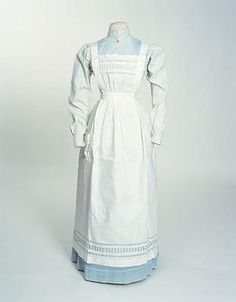1880 Servants' Apron, made of white linen with the bib pleated into the waistband. Two straps from the bib go over the shoulders to pin at back waist. Skirt pleated onto band which extends to form straps to pin at back. Pocket on right. Bib pocket and hem ornamented with insertions of coarse drawn-thread embroidery.