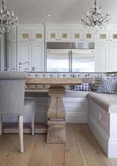 Dining Room booth built in the same cabinetry as the white kitchen. #booth #kitchen