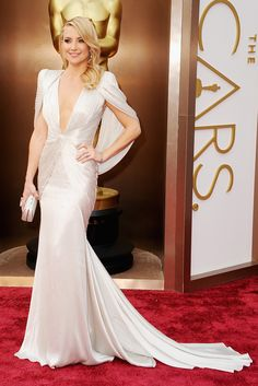 """The Best Looks From The Oscars #refinery29  http://www.refinery29.com/2014/03/63312/best-oscar-dresses-2014#slide9  Kate Hudson — For a star who's usually content to stop at """"pretty,"""" we have to hand it to Kate Hudson for taking this look all the way to """"stunning,"""" with a deep, deep V-cut neckline, dramatic shirring, and the strong-shouldered cape silhouette that was a red-carpet micro-trend this year."""