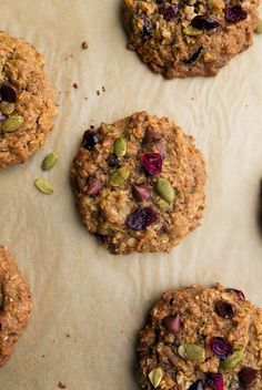 Pumpkin Spice Oatmeal Cookies with chocolate chips, dried cranberries, pepitas (pumpkin seeds), and coconut. The thick, chewy cookie you've been craving! #cookies #pumpkinspice #pumpkin #holiday #holidaybaking #christmas #christmascookie #holidaycookies