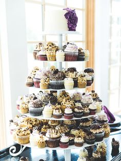 Guests won't be able to take their eyes off your dessert display with this over-the-top assortment of cupcakes and a small wedding cake.