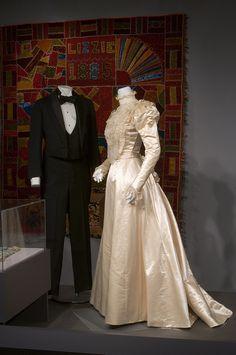 Wedding attire. LEFT:Black wool and silk satin tuxedo.  RIGHT: Ivory silk satin wedding dress, 1898.
